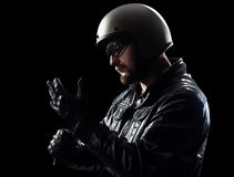 Biker Wearing glowes stock image