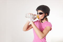 Biker woman drinking water Stock Images