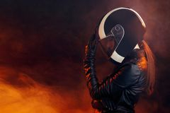 Biker Woman with Helmet and Leather Outfit Portrait royalty free stock photos