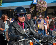 Biker Woman Riding in Oyster Run Event. ANACORTES, WA - SEPTEMBER 27: An unidentified woman rides in the 28th annual Oyster Run largest motorcycle run in the Royalty Free Stock Photo