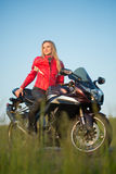 Biker  woman sitting on a motorcycle Royalty Free Stock Photography