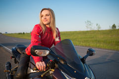 Biker  woman sitting on a motorcycle Stock Photography