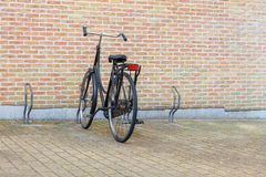 Bikerack. A stone wall is built of stone and mortar and a bikerack Royalty Free Stock Photo