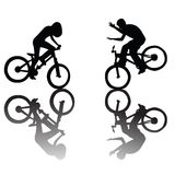 Bikers. Silhouettes of children riding a bike Stock Photo