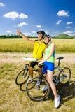 Bikers. Holding a map, Hazmburk, Ceske stredohori, Czech Republic Royalty Free Stock Photo