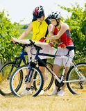 Bikers. Holding a map in vineyard, Czech Republic Royalty Free Stock Photography