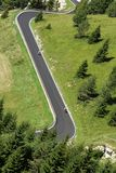 Bikers along the way with many curves Stock Photography