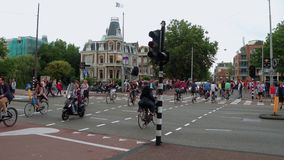 Bikers in Amsterdam - a typical street view - AMSTERDAM - THE NETHERLANDS - JULY 19, 2017. Bikers in Amsterdam - a typical street view - AMSTERDAM - HOLLAND stock video