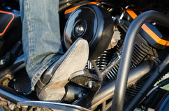 Bikers boot. And motor close-up Royalty Free Stock Photo