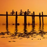 Bikers on bridge 2. Bikers on the ubein bridge with sunset 2 Royalty Free Stock Photography
