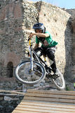 Bikers competition. THESSALONIKI,GREECE - SEPT,30: Unidentified  bikers take part Yedi Kule Runaway competition in Thessaloniki during Urban Downhill on Royalty Free Stock Images