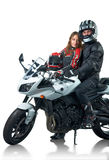 Bikers couple. In leather jackets with white motorcycle. Isolated on white Royalty Free Stock Photos