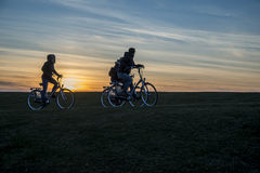 Bikers on dike Terschelling The Netherlands Royalty Free Stock Photos