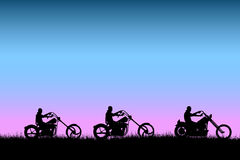 Bikers driving at sunset on the road. Vector illustration as silhouette of easy riders driving their motorbikes of type chopper on the road Stock Images