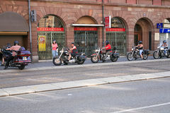 Bikers enter in hotel garage Stock Images