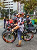 Bikers. On fat bikes in Singapore city Stock Photo