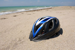 Bikers helmet on sea beach Stock Photo