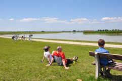 Bikers at a lake Stock Images