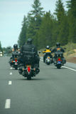 Bikers - motorcycles & leather. Bikers - motorcycles & leather on forested highwayCentral Oregon Royalty Free Stock Image