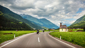 Bikers on mountainous highway Royalty Free Stock Image