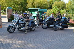 Bikers and priests Stock Photography