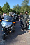 Bikers and priests Stock Photo