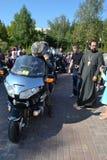 Bikers and priests Stock Photo