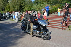Bikers and priests Stock Images