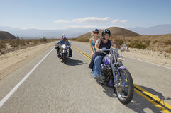 Bikers Riding On Country Road Stock Photography