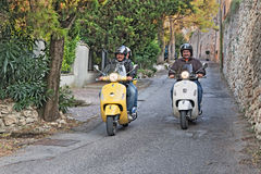 Bikers riding italian scooters. Happy bikers riding italian scooters during the rally coast to coast In Vespa dall'alba al tramonto on September 6, 2014 in Royalty Free Stock Photography