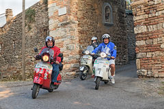 Bikers riding italian scooters Royalty Free Stock Images