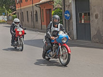 Bikers riding a vintage Ducati and Motobi Royalty Free Stock Image