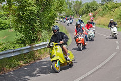Bikers riding a vintage scooters Lambretta. A group of bikers riding a vintage italian scooters at rally Innocenti Day of Lambretta club Umbria, on June 14, 2014 Stock Photos