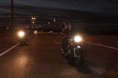 Bikers on road. Shot in motion Royalty Free Stock Images