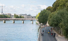 Bikers, runners, and walkers on the right bank of the Seine on a Royalty Free Stock Image