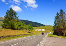 2 bikers in Scotland. 2 bikers riding on the mountainous A87 road in Glen Moriston, Scotland Stock Images