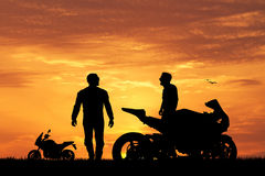 Bikers at sunset Royalty Free Stock Photo