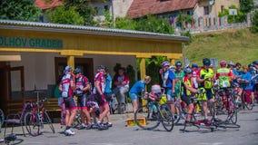 Bikers taking a break during marathon race through Slovenia stock video