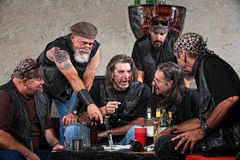Bikers Talking at Table Stock Images