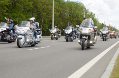 Bikers on their motorcycles in special clothes ride a collar on the outskirts Stock Photos
