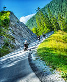Bikers tour along Alps. Group of bikers touring along Alpine mountains, active people enjoying extreme sport, motorcycle race, Austria, Europe Royalty Free Stock Image
