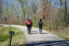 Bikers on a trail in the Wolf River Greenway Royalty Free Stock Images