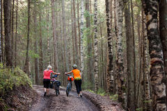 Bikers travel in difficult conditions in forest. Bikers travel in difficult conditions in autumn forest Stock Photo