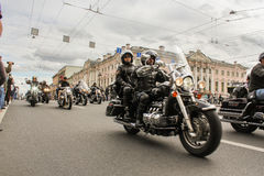 Bikers traveling on the Green Bridge. The annual parade of Harley Davidson in the squares and streets of St. Petersburg Royalty Free Stock Photography