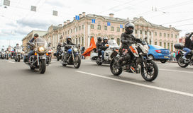 Bikers traveling on the Green Bridge. The annual parade of Harley Davidson in the squares and streets of St. Petersburg Stock Photos