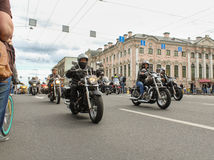 Bikers traveling on the Green Bridge. The annual parade of Harley Davidson in the squares and streets of St. Petersburg Stock Images