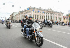 Bikers traveling on the Green Bridge over the Moika River. The annual parade of Harley Davidson in the squares and streets of St. Petersburg Royalty Free Stock Image