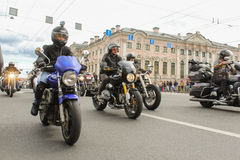 Bikers traveling on the Green Bridge over the Moika River. The annual parade of Harley Davidson in the squares and streets of St. Petersburg Royalty Free Stock Photography