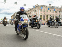 Bikers traveling on the Green Bridge over the Moika River. The annual parade of Harley Davidson in the squares and streets of St. Petersburg Stock Images