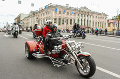 Bikers tricycle on the Green Bridge over the Moika River. Royalty Free Stock Photo